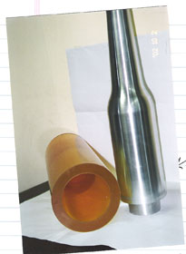 An isostatic press mold created bag and molding core pin shown.