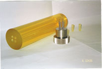 A bag and pressing mandrel created by a cold isostatic press mold are shown.
