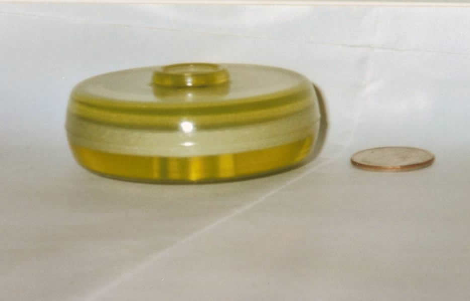 A urethane part by Elastomers' compared to a penny.